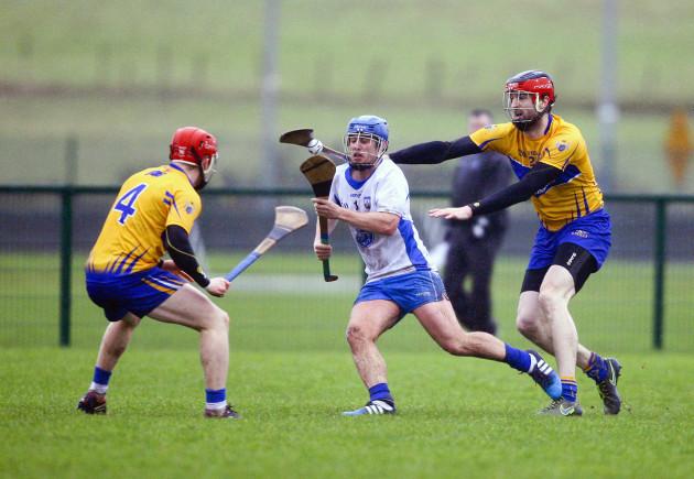 Brian Nolan in action against Darach Honan and Paul Flanagan