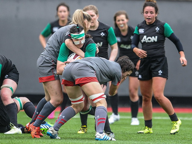 Paula Fitzpatrick is tackled by Adi Taviner and Melissa Clay