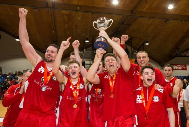 Shane Homan and Templeogue players celebrate with the cup