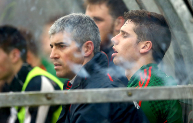 Lee Keegan on the bench following a head injury