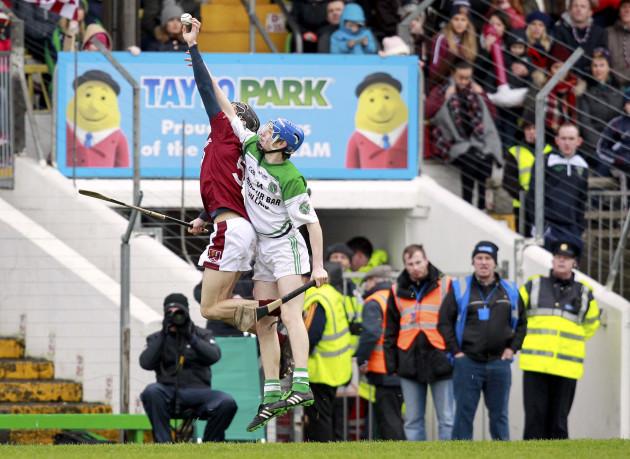 Karl McKeegan beats Niall Morrissey to the ball