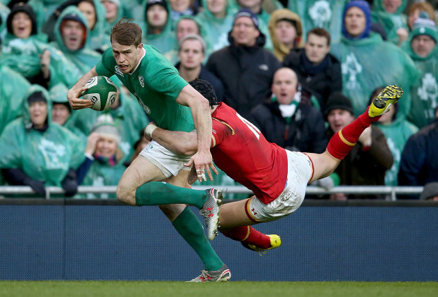 Andrew Trimble tackled by Tom James
