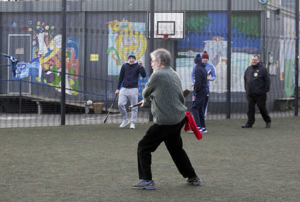 gerry adams playing hurling