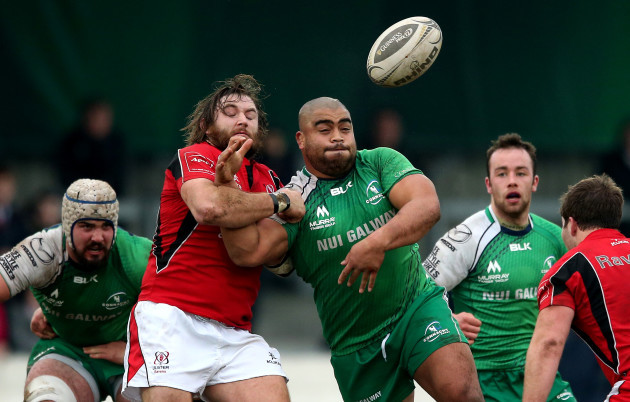 Rodney Ah You supported by Mick Kearney and Shane OÕLeary as he is tackled by Dave Ryan