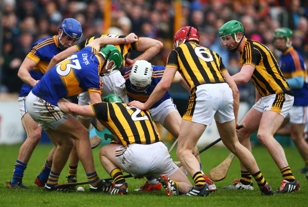 Kilkenny and Tipperary players search for a loose ball