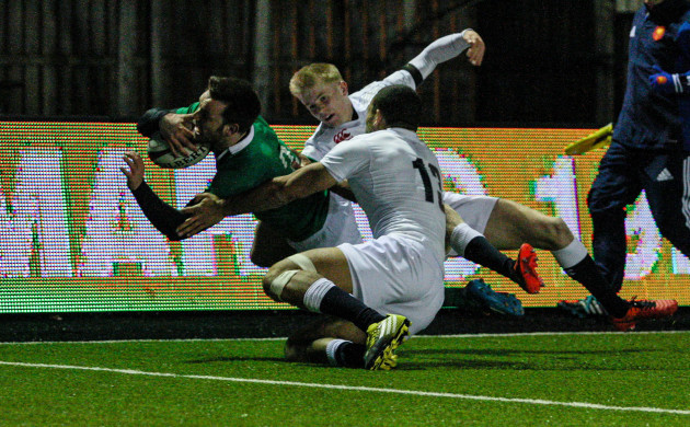 Matthew Byrne scores a try despite Joe Marchant and Mathew Protheroe