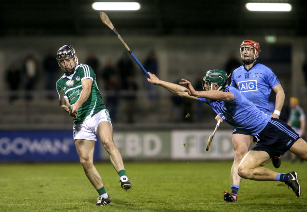 Chris Crummy attempts to block a shot from John Fitzgibbon