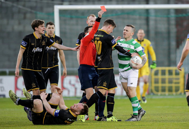 Neil Doyle shows Gary McCabe a red card