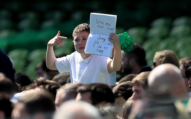 A young supporter holds up a sign