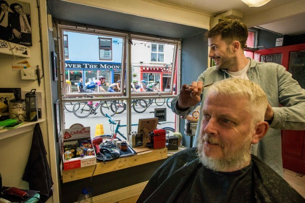 Mike Murphy has his hair cut by Owen Crudge as the An Post Rás finishes in Clonakilty