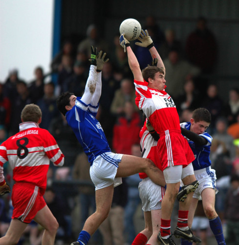 Seamie Coleman of Killybegs soars over Seamus Corcoran and Cathal Ellis of Naomh Conaill, Glenties, in the 2006 Donegal U-21 football championship. Photo courtesy of the Donegal Democrat