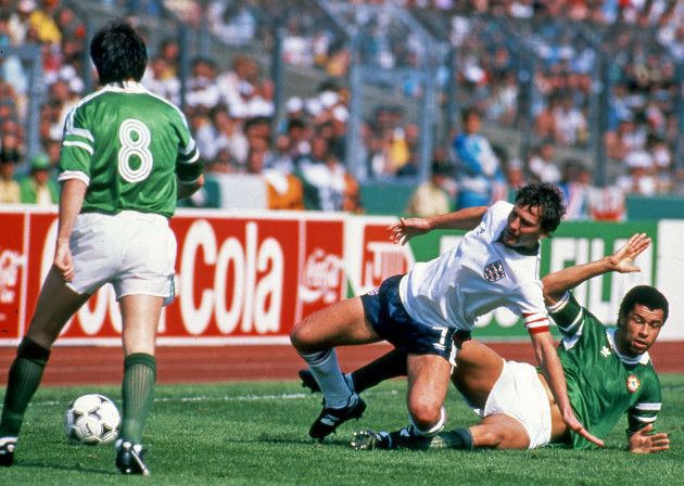 Paul McGrath tackled by Bryan Robson