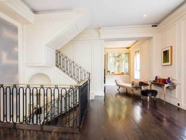 the-floor-consists-of-polished-wood-upstairs-and-maintains-the-white-colour-scheme-of-the-exterior