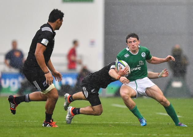 Hugo Keenan is tackled