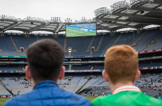 Fans keep an eye on the Ireland v France game