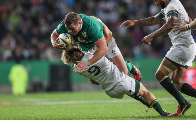 Tadgh Furlong is tackled by Faf de Klerk