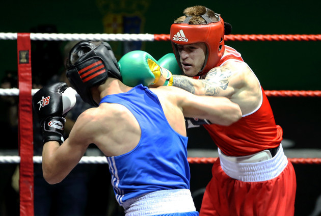 Steven Donnelly (red) in action against Khariton Agrba (blue)