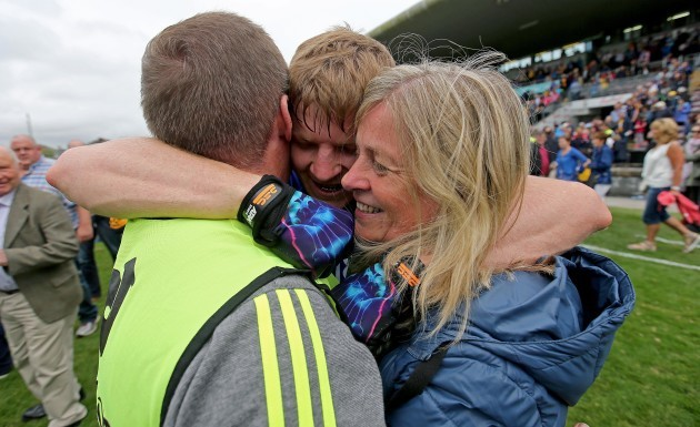 Podge Collins celebrates with his father Colm and his mother Katherine