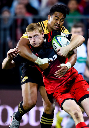 Johnny McNicholl is tackled by Julian Savea