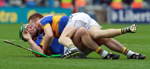 Noel McGrath and John O'Dwyer celebrate at the final whistle