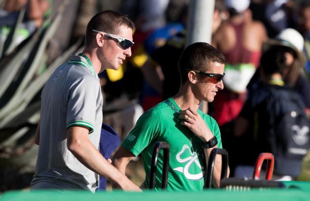 Brendan Boyce and Rob Heffernan watch the race