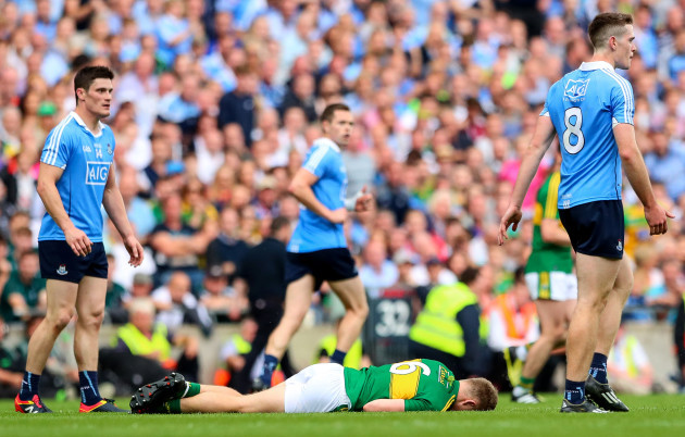 Peter Crowley lies injured after a late challenge