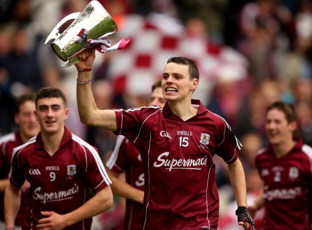 Sean Loftus lifts the trophy