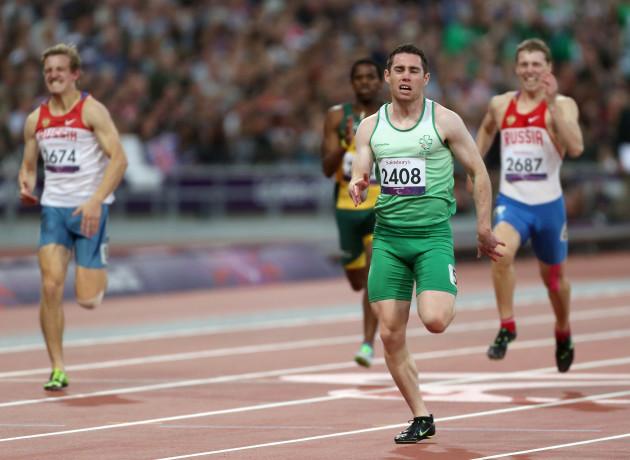 Reigning champion Jason Smyth wins 100m heat comfortably