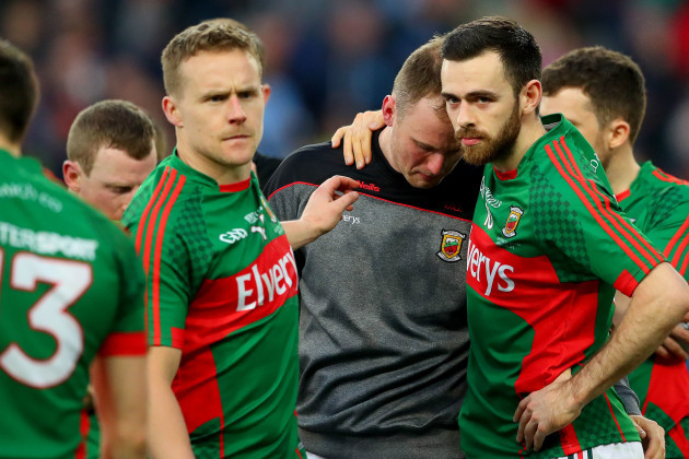 Robert Hennelly consoled by Andy Moran and Kevin McLoughlin after the game