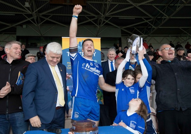 Thurles Sarsfields captain Padraic Maher raises the senior trophy with Laragh, Isabelle and Emma Griffin