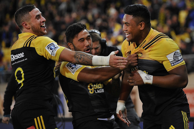 Julian Savea celebrates scoring a try with TJ Perenara and Vince Aso