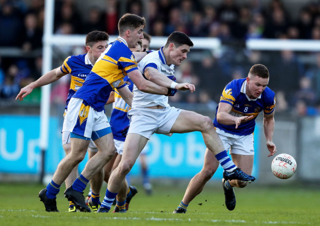 Diarmuid Connolly is tackled by Ciaran Kilkenny