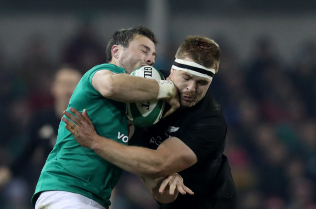 Ireland's Robbie Henshaw is tackled by New Zealand All Blacks Sam Cane