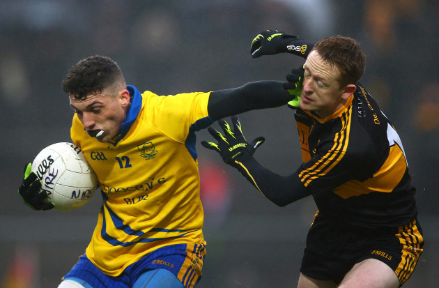 Colm Cooper takes Shane Ryan