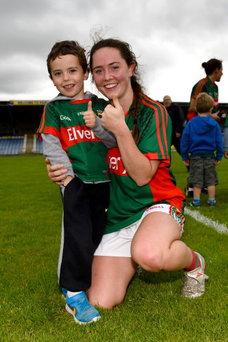 Doireann Hughes celebrates with a young Mayo fan at the end of the game