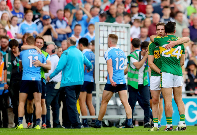 Marc Ó Sé and Aidan O'Mahony at the final whistle