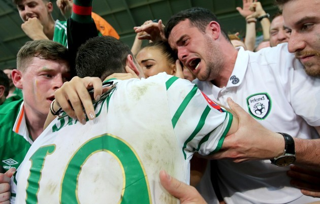 Robbie Brady celebrates with his girlfriend Kerrie Harris and his brother