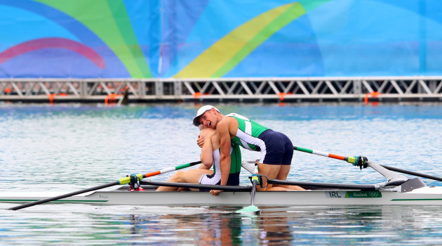 Gary and Paul O'Donovan celebrate winning silver medals