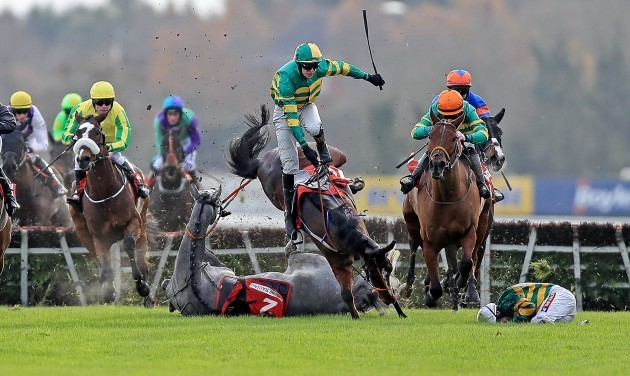 Campeador ridden by Barry Geraghty falls at the last as Sir Scorpion ridden by Mark Walsh collide with them