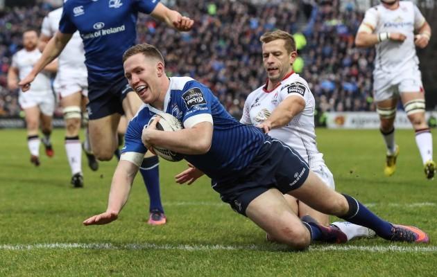Rory O'Loughlin scores a try despite Paul Marshall