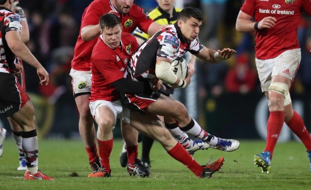 Munster's Johnny Holland tackles Edinburgh's Damien Hoyland