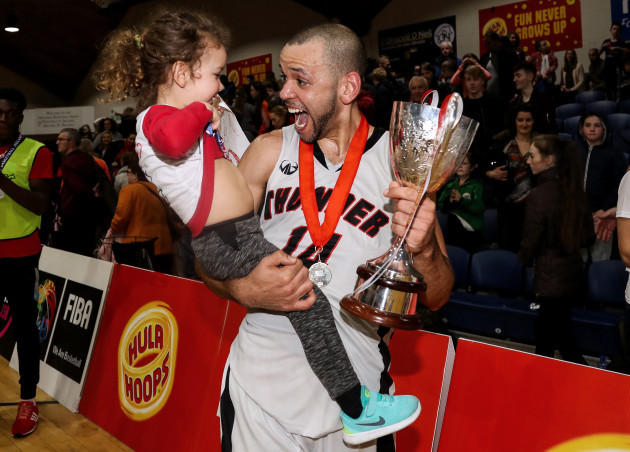 Isaac Westbrooks celebrates after the game with his daughter Eabha