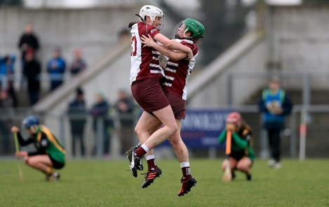 Josie McMullan and Siobhan McKaigue celebrate at the final whistle