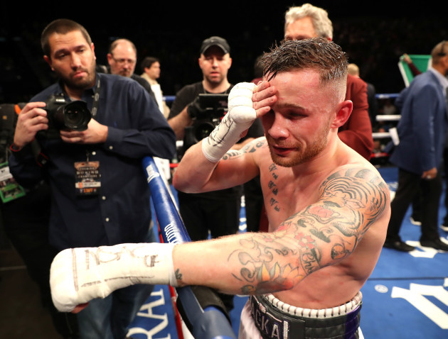 Carl Frampton dejected after losing