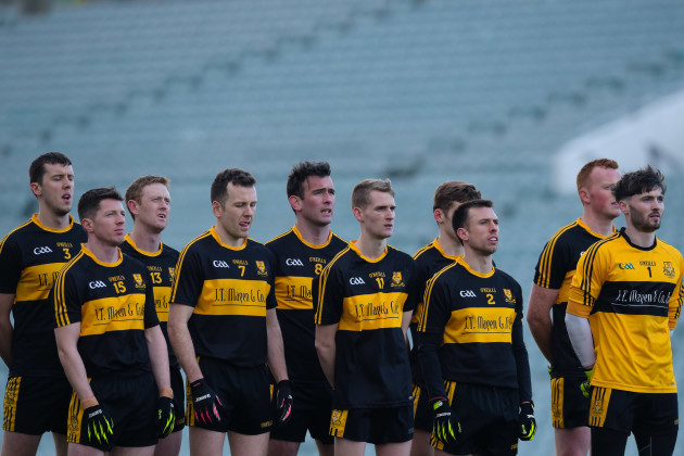 Dr. Crokes players stand for the national anthem
