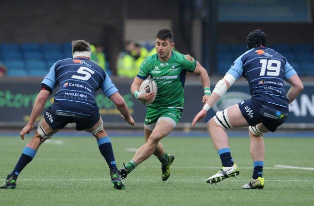 Tiernan O'Halloran is tackled by James Down and Seb Davies