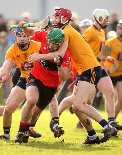 Tom Devine under pressure from Paudie Foley