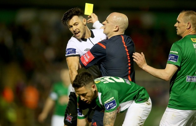 Richie Towell is held back by Rob Rogers