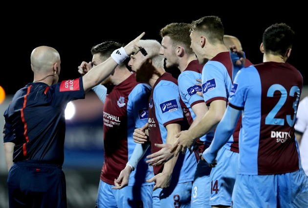 Drogheda players surround referee Rob Rogers after sending Jason Marks off