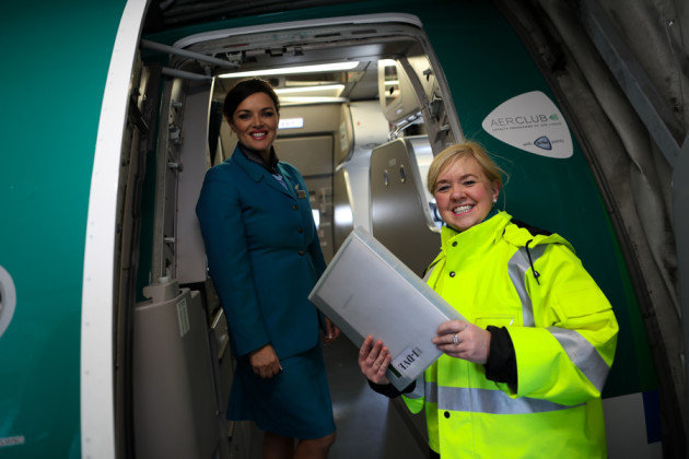 Turnaround Coordinator Eileen Quinn liaises with Cabin Service Manager Fiona Power ahead of Aer Lingus flight EI162 which departed for London Heathrow from Dublin at noon today.